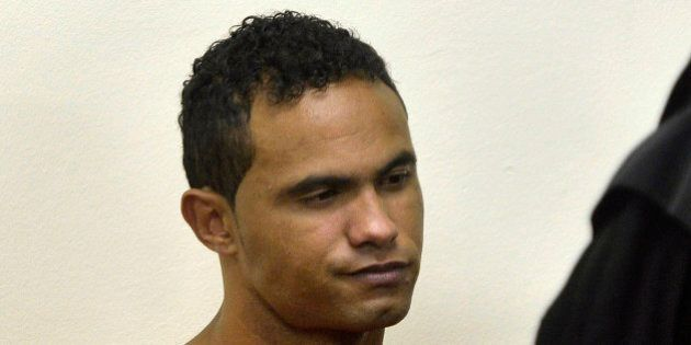 Bruno Souza, former goalkeeper of Brazil's Flamengo soccer club, sits in court during his trial in Contagem,...