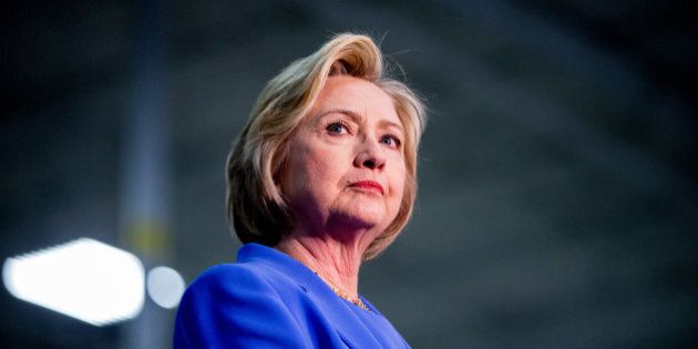 Democratic presidential candidate Hillary Clinton stands on stage at the Union of Carpenters and Millwrights...