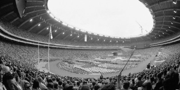 The curving Olympic Stadium of Montreal is filled to capacity during the opening ceremony of the 21st...