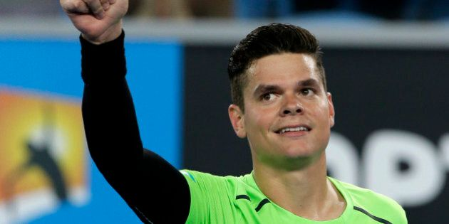 Milos Raonic of Canada celebrates after defeating Donald Young of the U.S. during their second round...