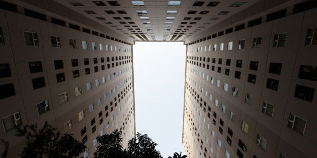 A residential apartment building stands in Jakarta, Indonesia, on Tuesday, June 23, 2015. Having watched...