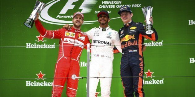 SHANGHAI, CHINA - APRIL 09: Race winner Lewis Hamilton (C) of Great Britain and Mercedes GP with second...