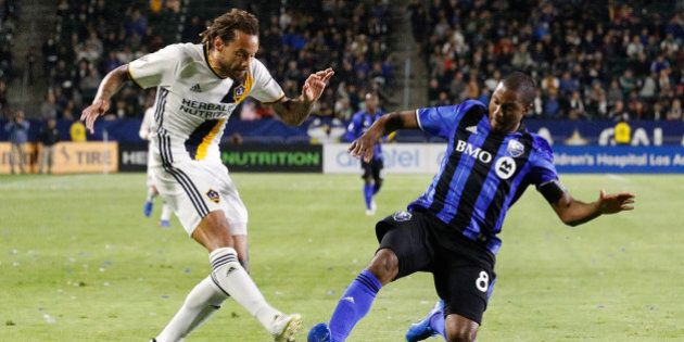CARSON, CA - APRIL 07: Jermaine Jones #13 of the Los Angeles Galaxy attempts to kick the ball while Patrice...