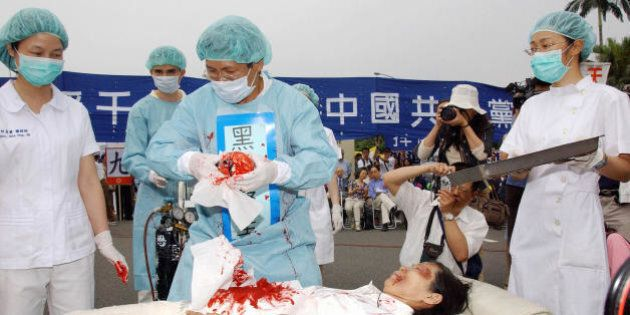 Taipei, TAIWAN: During a rally joined by thousands of Falun Gong practitiioners at Taipei 23 April 2006,...