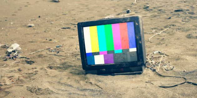 old TV playing color bars in desert .with path on
