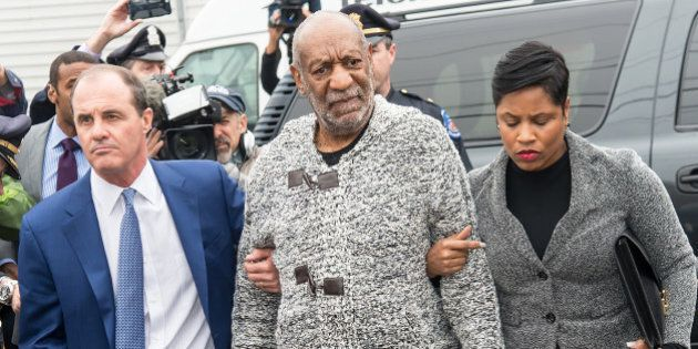 ELKINS PARK, PA - DECEMBER 30: Comedian Bill Cosby (C) arrives on December 30, 2015 at the District Court...