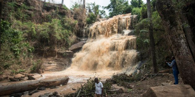 People walk in front of the Waterfalls in Kintampo on March 20, 2017, where 20 students lost their life...