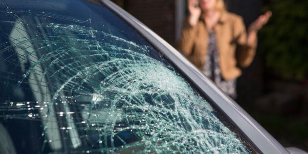 Woman Phoning For Help After Car Windshield Has