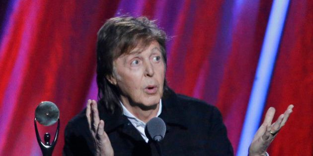 FILE- In this file photo dated Sunday April 19, 2015, Paul McCartney introduces Ringo Starr at the Rock...