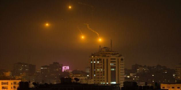 TOPSHOT - Flares are seen over Gaza City on February 6, 2017.Israel struck a number of Hamas positions...