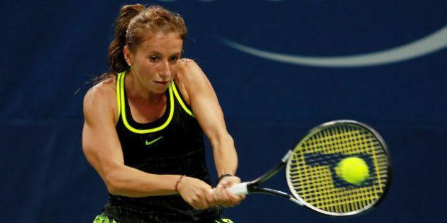 NEW YORK, NY - SEPTEMBER 01: Annika Beck of Germany returns a shot to Elena Vesnina of Russia during...