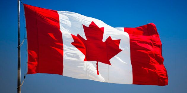 Maple leaf flag flying in the