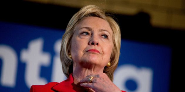 In this May 16, 2016 photo, Democratic presidential candidate Hillary Clinton waits to speak at a get...