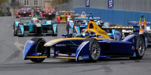Renault e.dms driver Sebastian Buemi of Switzerland steers his car during the Formula E Paris ePrix auto...
