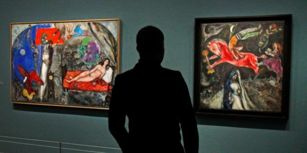 A member of the media views a painting by Russian artist Marc Chagall before the opening of the exhibition:...