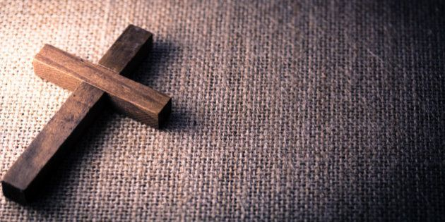 An aerial view of a holy wooden Christian cross on a burlap