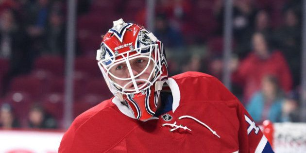 MONTREAL, QC - JANUARY 14: Ben Scrivens #40 of the Montreal Canadiens warms up prior to the game against...
