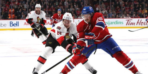 Nov 22, 2016; Montreal, Quebec, CAN; Montreal Canadiens defenseman Jeff Petry (26) plays the puck against Ottawa Senators right wing Mark Stone (61) during the third period at Bell Centre. Mandatory Credit: Jean-YvesAhern-USA TODAY Sports