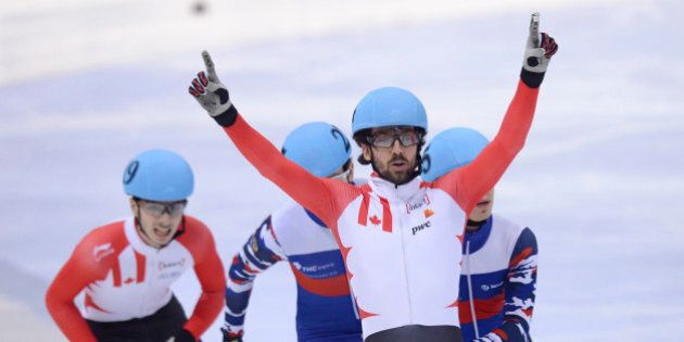 DRESDEN, GERMANY - FEBRUARY 07: Charles Hamelin of Canada celebrates after the Men 500 M Final during...