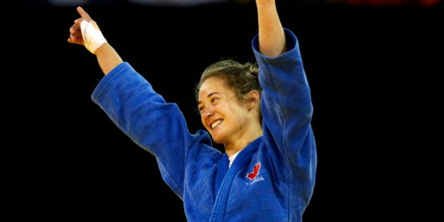 Canada's Stefanie Tremblay celebrates after beating Brazil's Mariana Silva during a women's -63kg judo...