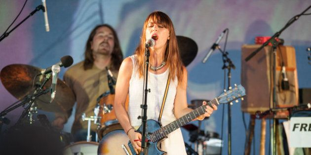 COLOGNE, GERMANY - AUGUST 21: Feist performs on stage at the Tanzbrunnen on August 21, 2012 in Cologne,...