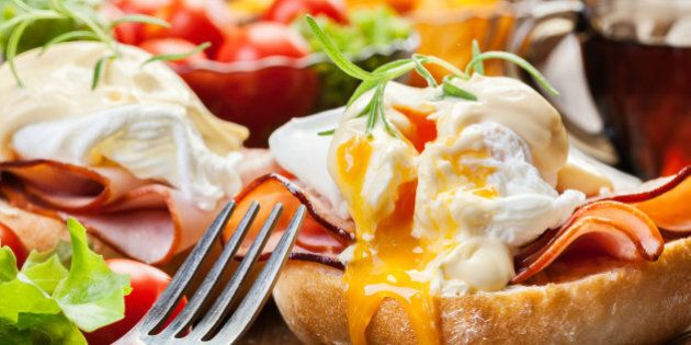 Eggs Benedict on toasted muffins with ham and