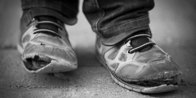 Village boy in Turkey wearing pair of old