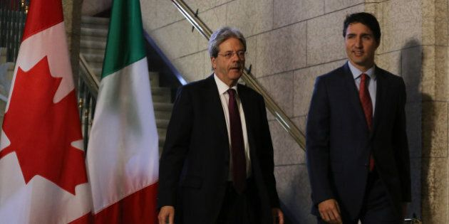 Canadian Prime Minister Justin Trudeau (R) and Prime Minister Paolo Gentiloni of Italy, arrive for a...