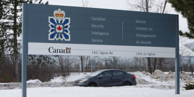 A vehicle passes a sign outside the Canadian Security Intelligence Service (CSIS) headquarters in Ottawa,...