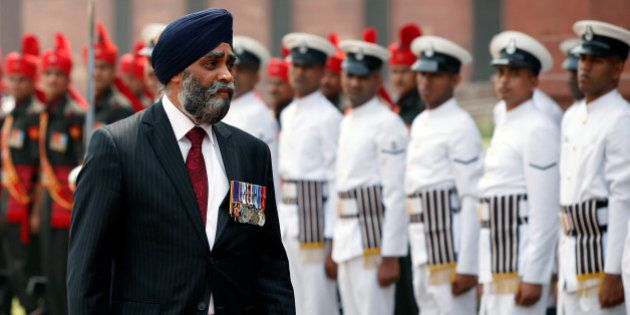 Canada's Defence Minister Harjit Sajjan inspects an honour guard during his ceremonial reception in New...