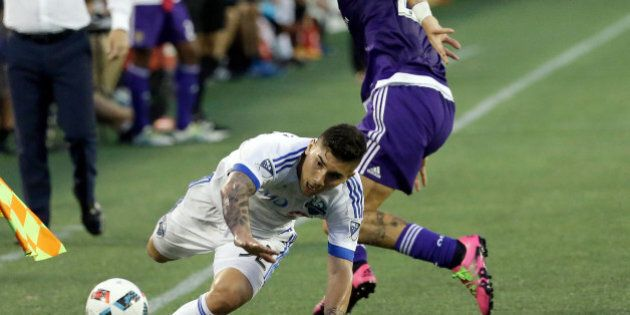 Montreal Impact's Lucas Ontivero, left, and Orlando City's Brek Shea collide while going for the ball...