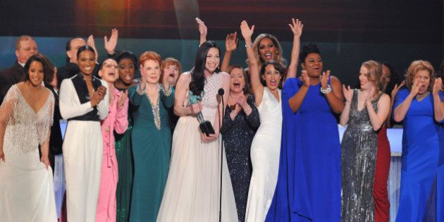 "Laura Prepon, center, and the cast and crew of ""Orange is the New Black"" accept the award for outstanding..."