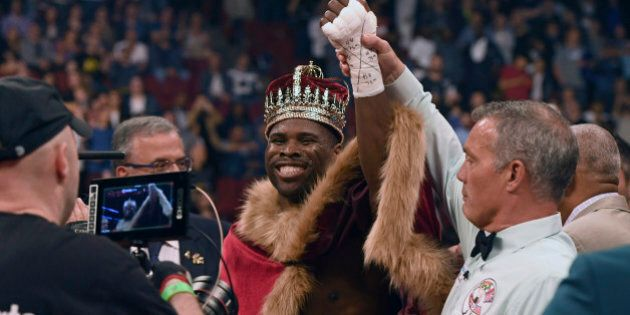 Jun 3, 2017; Montreal, QC, Canada; referee Michael Griffin lift the arm of Adonis Stevenson after his...