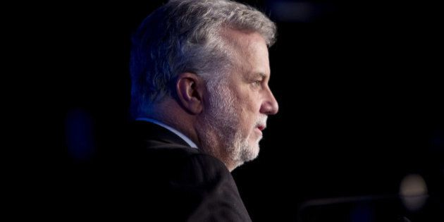 Philippe Couillard, premier of Quebec, pauses while speaking during the International Economic Forum...