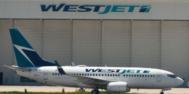 WestJet plane parked at Toronto Pearson International Airport.On Wednesday, 22 June 2016, in Toronto,...