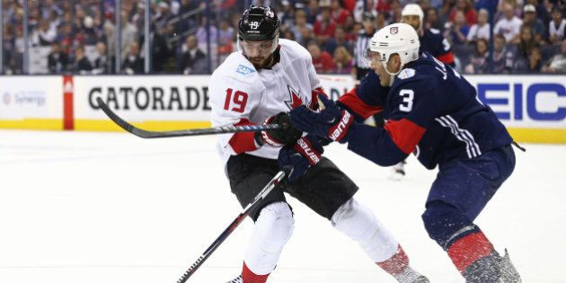 Sep 9, 2016; Columbus, OH, USA; Team Canada forward Tyler Seguin (19) is checked off the puck by Team USA defenseman Jack Johnson (3) in the third period during a World Cup of Hockey pre-tournament game at Nationwide Arena. Mandatory Credit: Aaron Doster-USA TODAY Sports