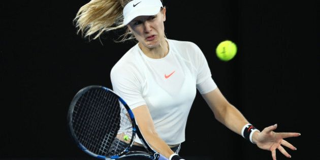 MELBOURNE, AUSTRALIA - JANUARY 20: Eugenie Bouchard of Canada plays a forehand in her third round match...
