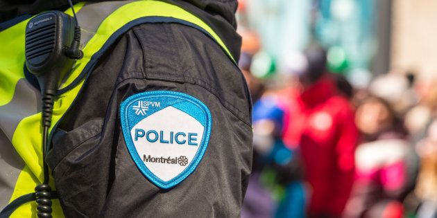 Montreal, Canada - 19 March 2017: Close-up of a police patch with crowd n the background at St. Patrick's...