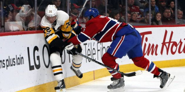 Jan 18, 2017; Montreal, Quebec, CAN; Pittsburgh Penguins right wing Patric Hornqvist (72) is checked into the boards by Montreal Canadiens defenseman Shea Weber (6) during the first period at Bell Centre. Mandatory Credit: Jean-Yves Ahern-USA TODAY Sports