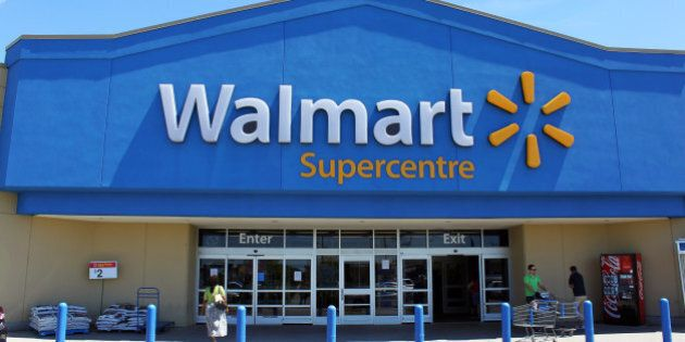 Etobicoke, Ontario, Canada - July 24, 2013: Customers in front of a Walmart Supercenter. Walmart is an...