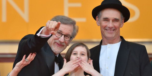 US director Steven Spielberg, US actress Ruby Barnhill and British actor Mark Rylance cheer on May 14,...