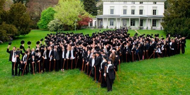 Some 662 people dressed as 'The Tramp' pose for a group picture to mark the first anniversary of Chaplins...