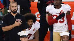 Par solidarité, ces athlètes ne se lèvent pas pendant l'hymne