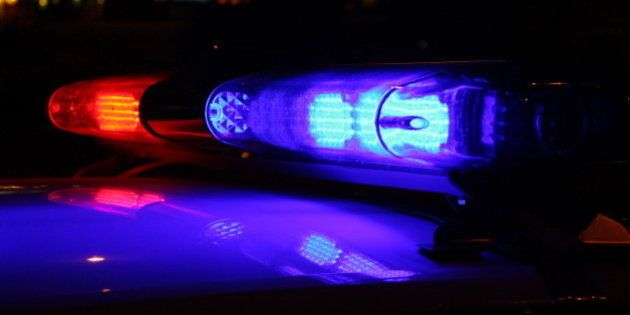 A close-up photo of police lights at night
