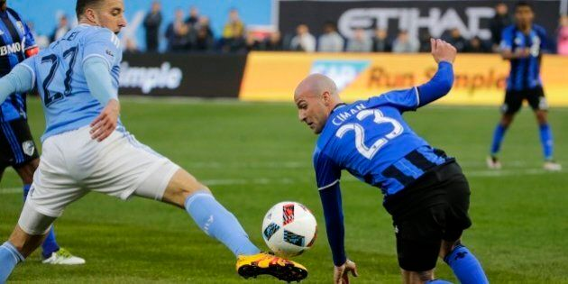 Montreal Impact's Laurent Ciman (23) defends New York City FC's RJ Allen (27) during the first half of...