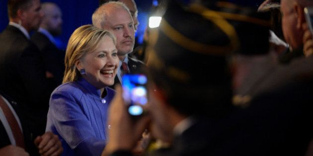 Democratic presidential nominee Hillary Clinton greets members of the audience following an address to...
