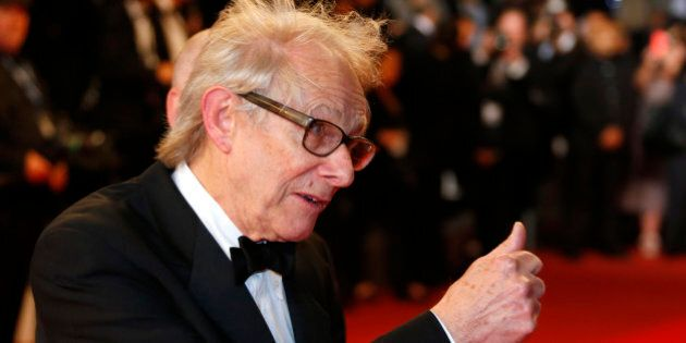Director Ken Loach poses on the red carpet as he arrives for the screening of the