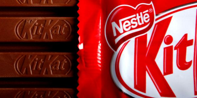 Bars of original KitKat chocolate, produced by Nestle SA, and without the 'Fairtrade' logo sit arranged...