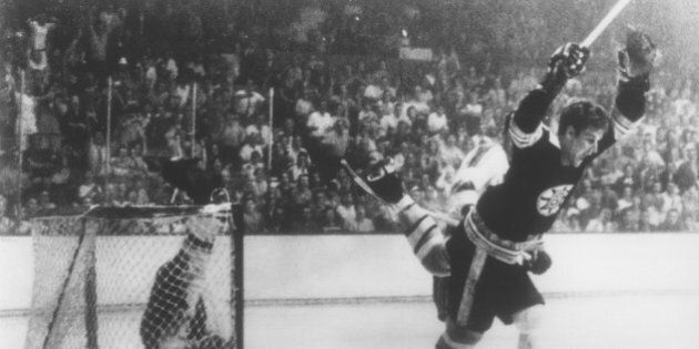 BOSTON, MA - MAY 10: Bobby Orr #4 of the Boston Bruins flies through the air after sliding the puck past...