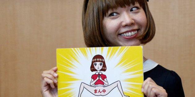 Japanese artist Megumi Igarashi, known as Rokudenashiko, holds her artwork after a news conference following...